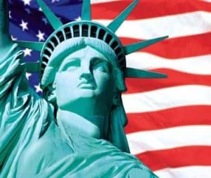 Statue of Liberty in Front of American Flag